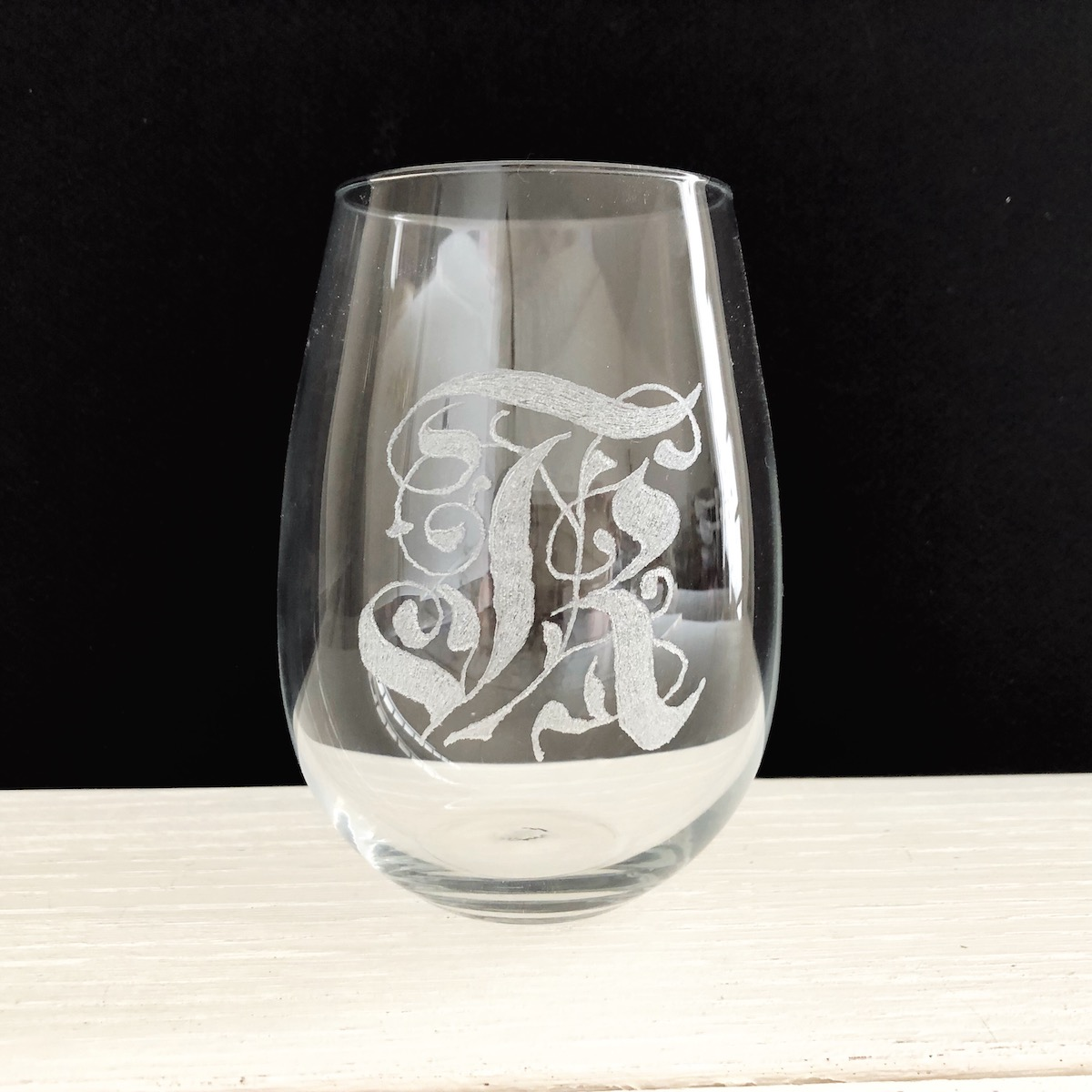 Engraving K on glass